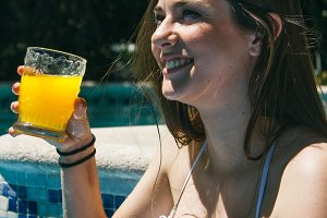 Woman drinking in a pool