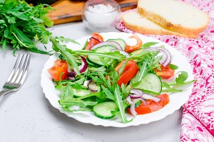 salad with tomatoes, cucumbers and a