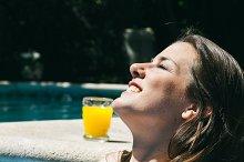 Woman sunbathing in a pool