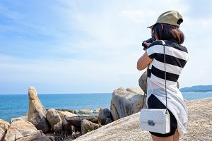 Woman taking photos at the Hin Ta Hi