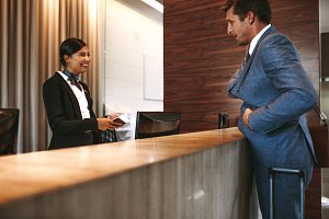 Businessman checking in at hotel