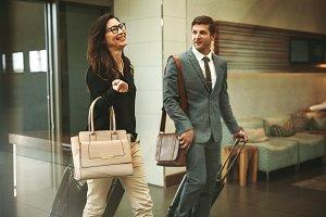 Business travelers walking through