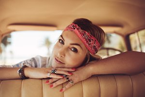 Woman relaxing in a old car
