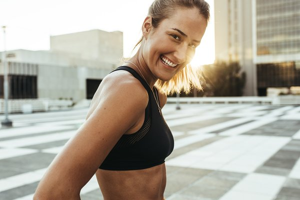 Close up of a woman jogger standing…