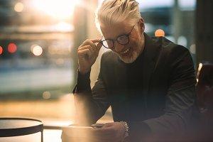 Businessman enjoying watching online