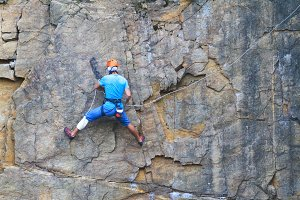 Climber fixes insurance on a steep