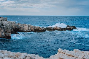 Sea waves splashing against rocky