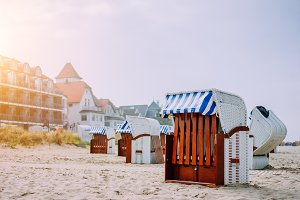 Blue striped roofed chairs on sandy