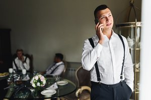 Groom talks on the phone