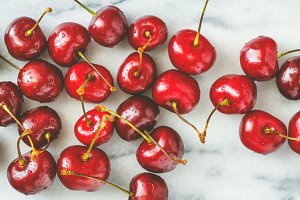 Ripe cherry on a white marble