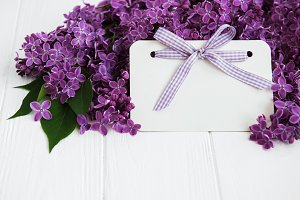 Lilac flowers with greeting card on