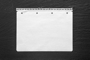 White paper sheet on black