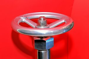 Industrial valve on a red background