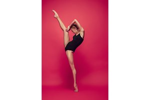 Young teen dancer on red studio