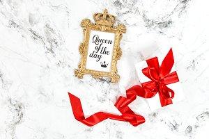 Golden frame gift box red ribbon bow