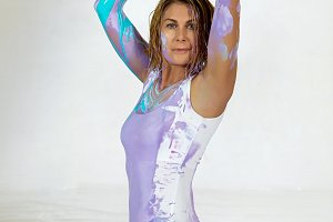 woman yogi covered with purple paint