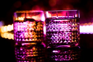 bar colored lights with glasses of a