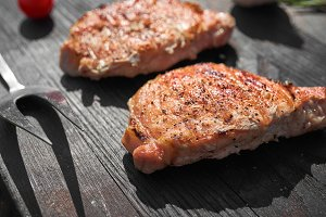 Pork steaks cooking on barbecue