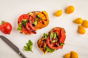 Sandwiches with tomatoes and cheese