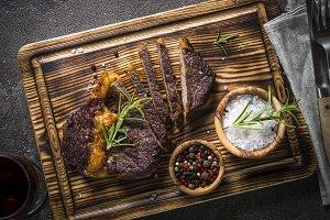 Grilled beef steak medium well on