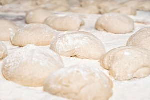 Raw fresh dough in industrial bakery