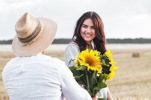 Beautiful couple with sunflowers