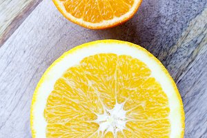cut half orange and mandarin