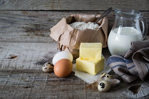 Baking ingredients on rustic wood