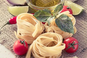 Pasta and ingredients on rustic