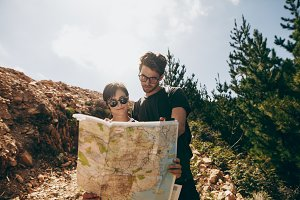 Explorer couple looking at a map