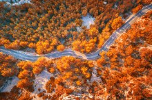 Aerial view of mountain curve road by  in Transportation