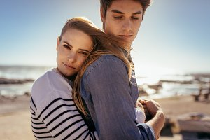Couple standing together at a beach