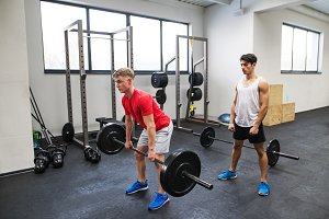 Fit young men in gym working out
