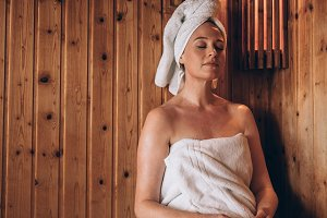 Woman sitting in a spa with eyes