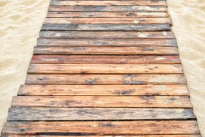 Natural wood planks on the sand