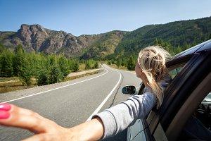 A blonde woman  in car