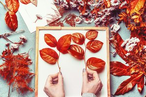 Female hands with autumn leaves