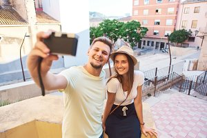 Couple of tourists taking selfie in