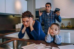 Sad boy with his parents arguing