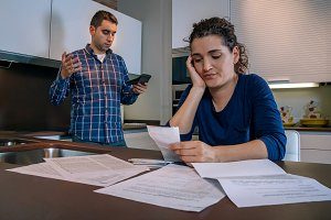 Desperate young couple with debts re