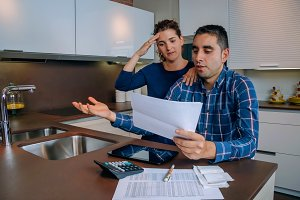 Unemployed young couple with debts r