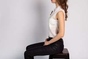girl in white jacket and black pants