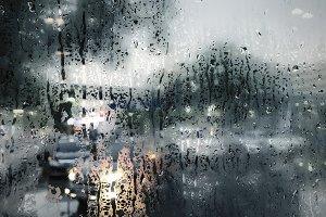 Raindrop on window in rainy season