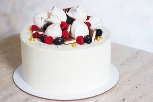 White festive cake with meringue and