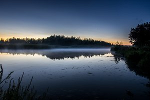 Evening fog on the river. Sunset by