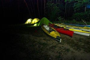 Camping camp. Tents and kayaks. Tour
