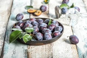 Plum fruits rustic wooden background