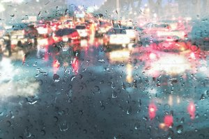 Raindrop on car mirror in rainy day