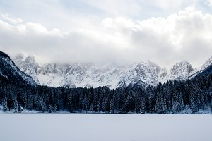 Frozen Lake with snowy mountains