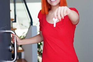 Happy woman with red hair opening he